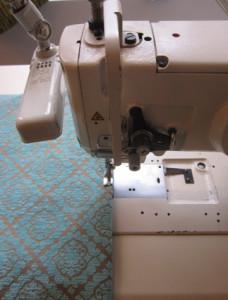 stof onder naaimachine